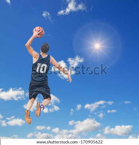 left-handed dunk in the sun