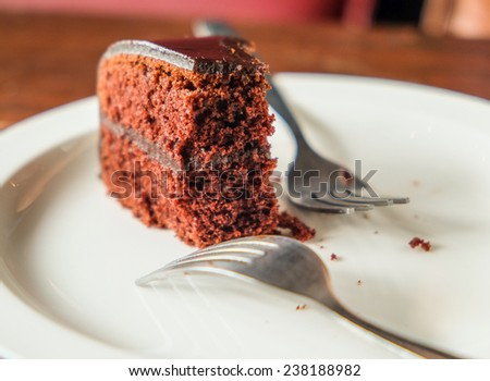 left over chocolate cake, selected focus on chocolate cake. - stock photo