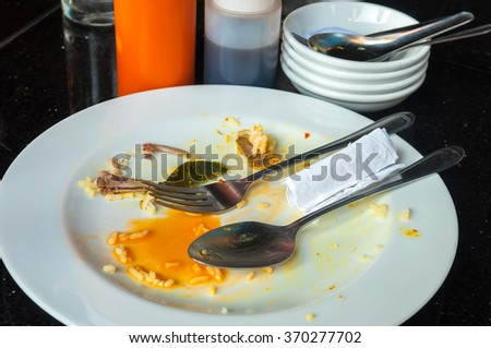 Left over food on place after breakfast - stock photo
