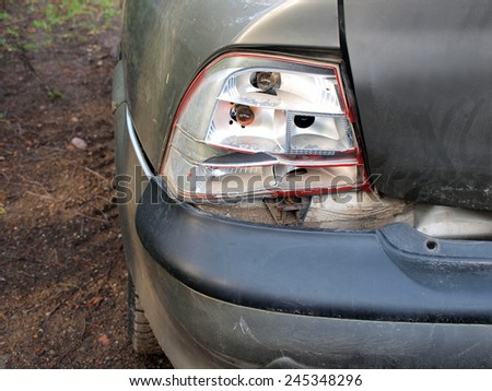 Left rear lights of car damaged in road accident, horizontal - stock photo