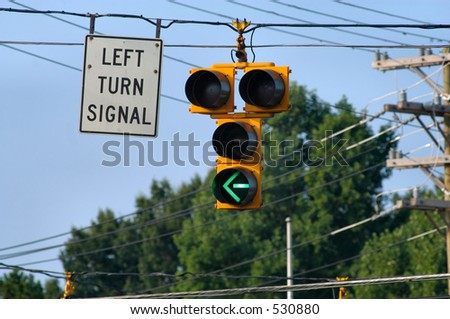 Left Turn Signal - Green - stock photo