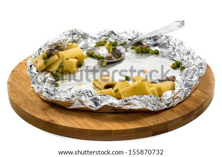 leftover food in woodenboard on white background - stock photo