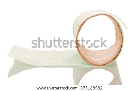 Leftover tissue paper roll on white isolate background - stock photo
