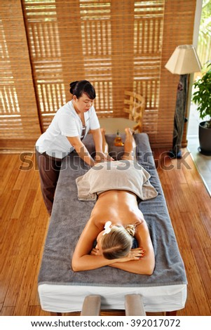 Leg Massage Therapy In Spa Salon. Body, Skin Care. Beautiful Young Woman Relaxing, Masseur Massaging Long Female Legs With Aromatherapy Oil. Beauty Treatment Concept. Wellness, Healthy Lifestyle. - stock photo