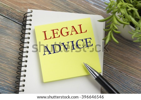 Legal Advice. Notepad with message, pen and flower. Office supplies on desk table top view - stock photo
