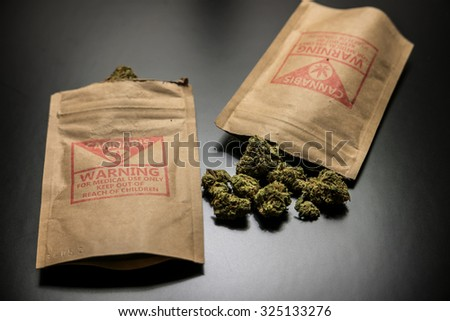 Legal Cannabis Flowers and Packages. Legal cannabis and it's package purchased from a retail storefront in Portland, Oregon.