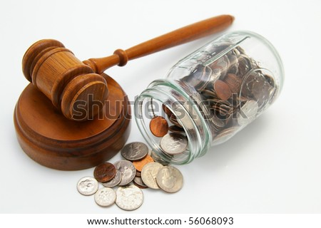 legal court gavel and money from a coin jar - stock photo