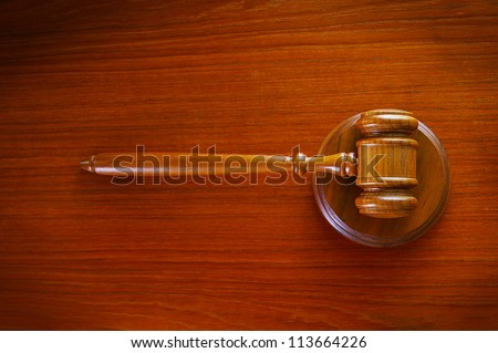 legal court gavel on a desk, top view - stock photo
