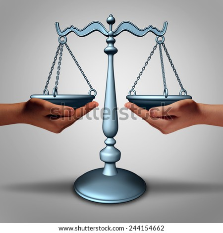 Legal support and lawyer advice concept as two hands holding a justice scale as a metaphor and law symbol for court services and contract advice. - stock photo