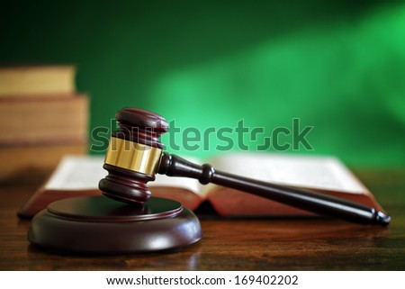 Legal system concept gavel and law books in courthouse - stock photo