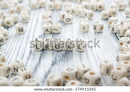 LEGAL word written on wood block. Wooden ABC. - stock photo