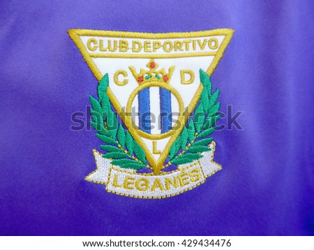 LEGANES, MADRID - MAY 29, 2016: sewed patch in a t-shirt with Leganes Soccer Club symbol. Leganes is about to promote to first division soccer spanish league - stock photo