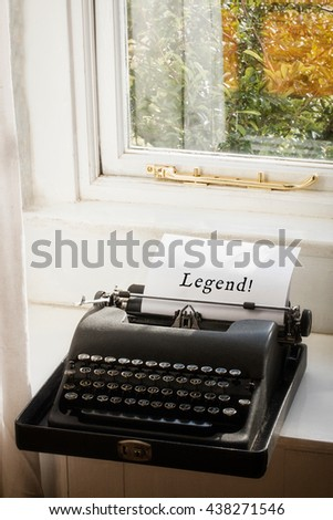 Legend! message against typewriter on a table - stock photo