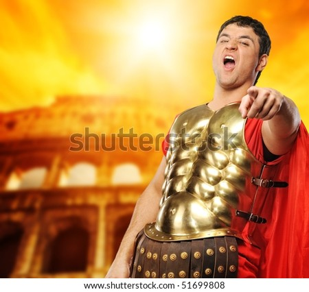 Legionary soldier in front of coliseum - stock photo