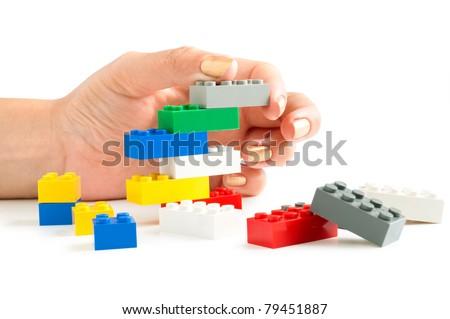 lego bricks with hand - stock photo