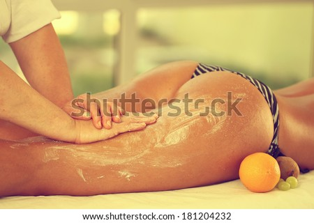 Legs and buttocks massage in the spa center - stock photo