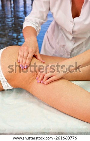 Legs and buttocks woman massage to reduce cellulite - stock photo