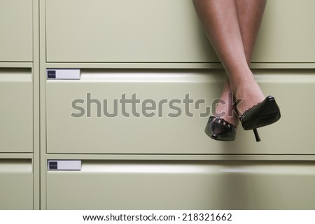 Legs and feet of businesswoman - stock photo
