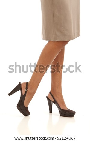 Legs and feet of young business woman wearing a suit