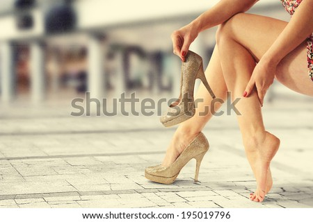 legs and gold shoes  - stock photo