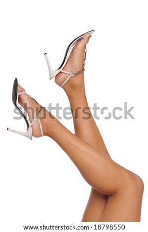 Legs and high heels isolated on a white background - stock photo