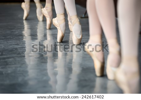 Legs dancers on pointe, near the choreographic training machine. - stock photo