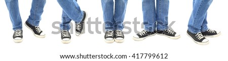 Legs in blue jeans and black canvas sneakers in 5 positions, isolated on white with clipping path