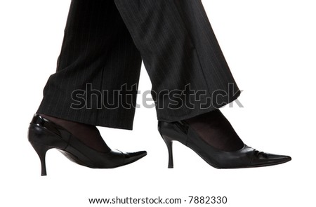 Legs in shoes and trousers isolated at the white background