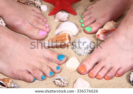 legs in the sand and shells as nice background - stock photo
