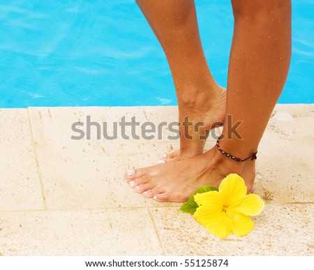 Legs in the swimming pool.Vacation concept - stock photo