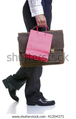 Legs of a man carrying a red gift bag and briefcase, isolated on a white background. - stock photo