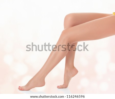 Legs of a woman against abstract pastel background