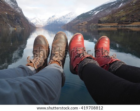 Legs of a young couple in love near the lake, Flam, Norway