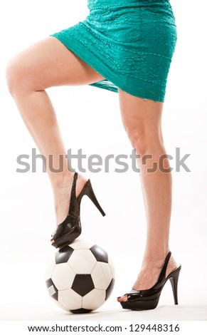 Legs of attractive soccer mom in her forties - stock photo