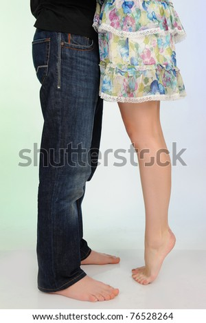 Legs of beautiful couple kissing. studio shot - stock photo