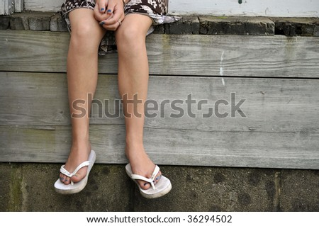legs of child sitting alone