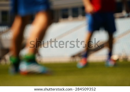 Legs of football players in the blurring - stock photo