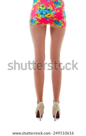 Legs of Sexy blonde Fashion Lady isolated on white. Beautiful woman with long straight blond hair. Fashion model posing at studio. Close up - stock photo