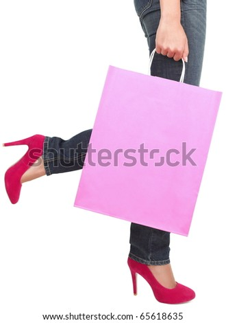 Legs of shopping lady showing shopping bag with copyspace. Isolated on white background. - stock photo
