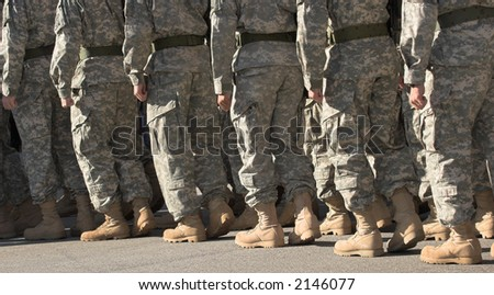 Legs of soldiers in marching step