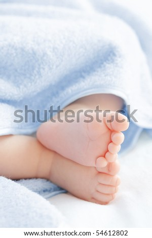 Legs of the small baby in a bath towel