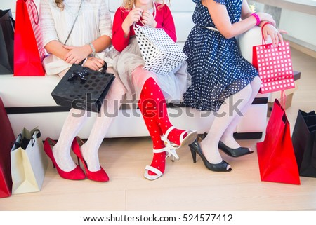 legs of  three little cute girlfriends fashioners on shopping