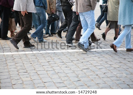 Legs of tourists on  Red Square - stock photo