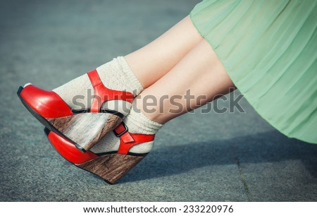 Legs of woman with high heels dressed green dress vintage style  - stock photo