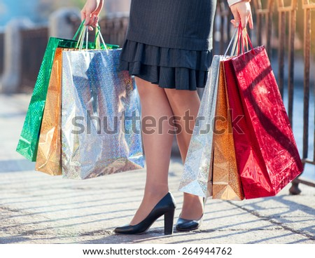 Legs of woman with shopping bags in the city outdoor - stock photo