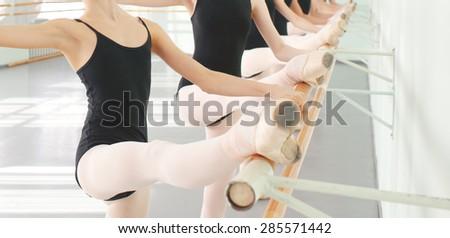 legs of young dancers ballerinas in class classical dance, ballet - stock photo