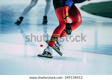 legs women athletes skater during race at sprint distance. speed skating  indoors