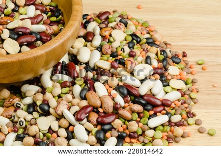 legumes on wood, closeup, background - stock photo