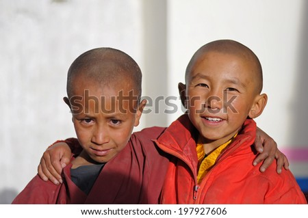 LEH IN LADAKH, INDIA - SEPTEMBER 7 2012: Young unidentified buddhist monks outside the Thiksey monastery in Leh. The majority of the local population are descendant of Tibetan.