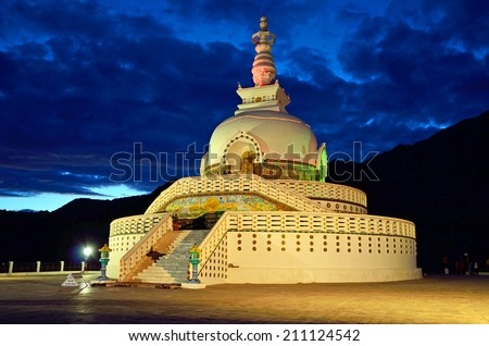 LEH, INDIA AUGUST 1, 2014: Shanti Stupa is a Buddhist stupa on a hilltop in Leh city and was built in 1991 by Japanese Buddhist. - stock photo